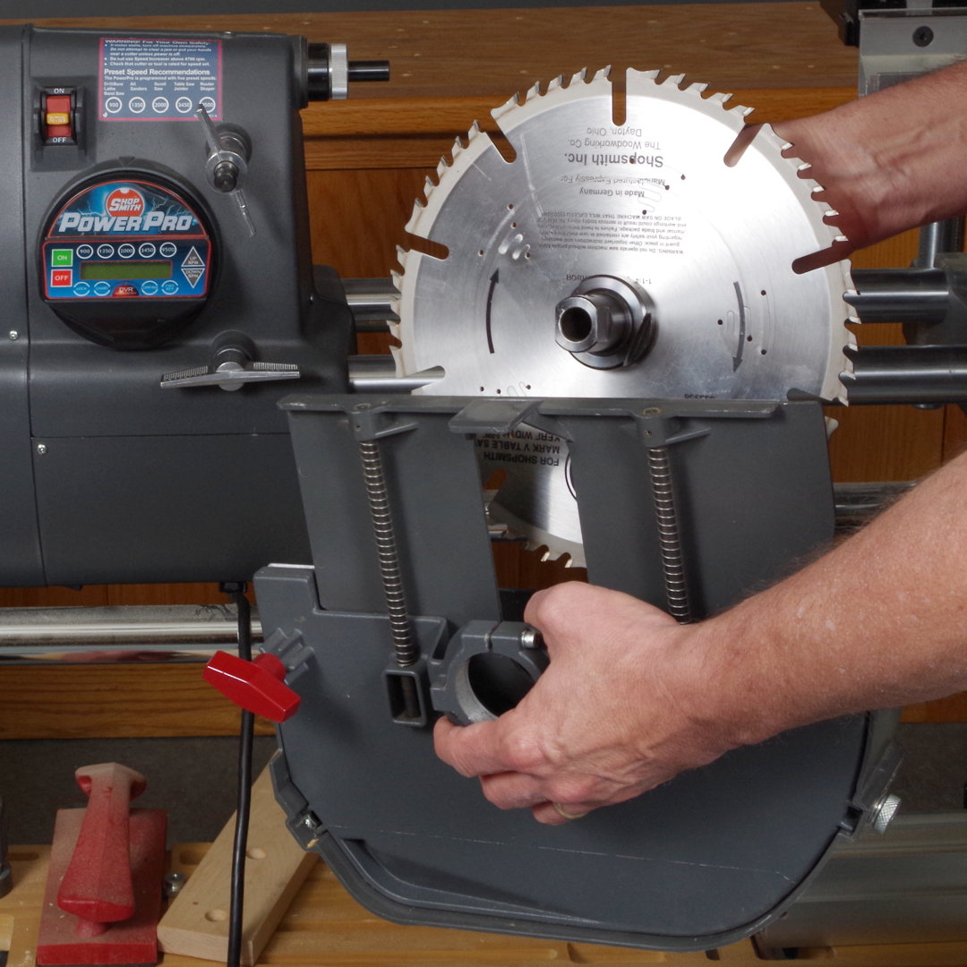 Shopsmith step 2 assembling the table saw components slide saw blade into lower saw guard greentooth