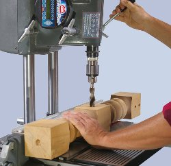 Over table drill press operation